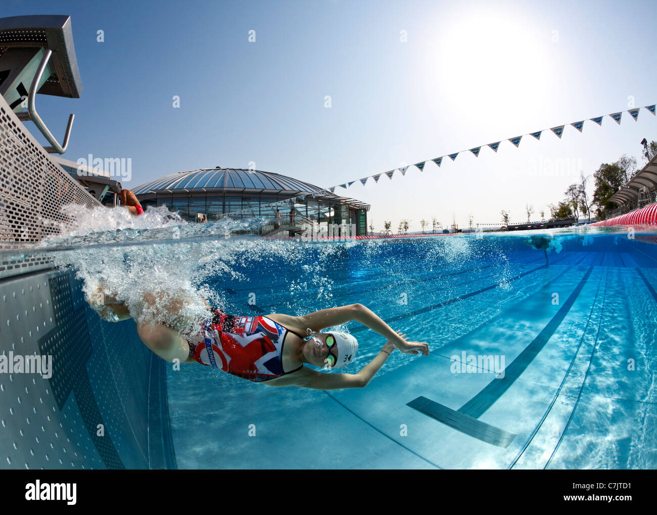 A Female Swimmer Training In An Open Air Olympic Swimming Pool Stock Photo 39137645 Alamy