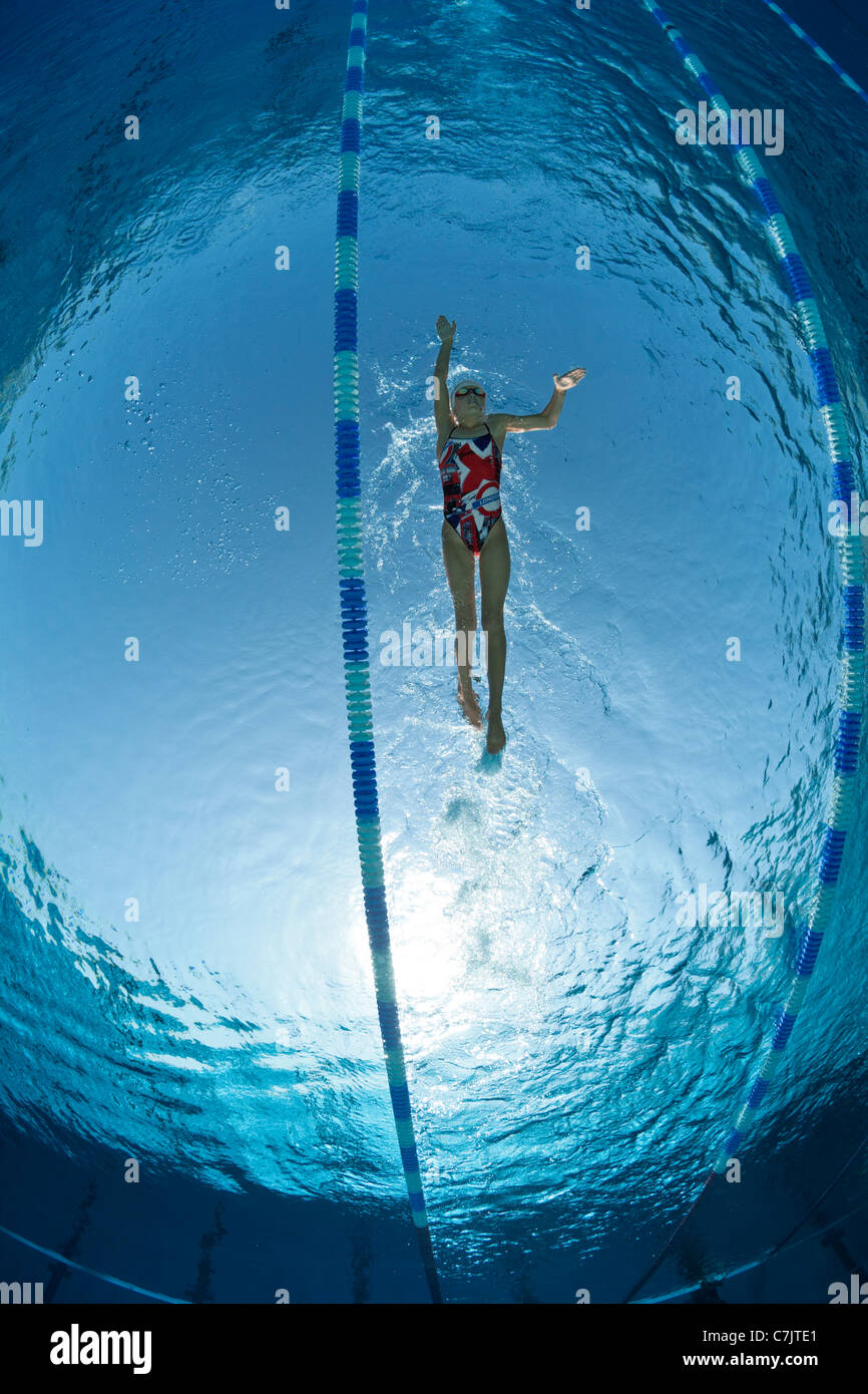 A female swimmer training in an open air Olympic swimming pool (France). Underwater view. Stock Photo