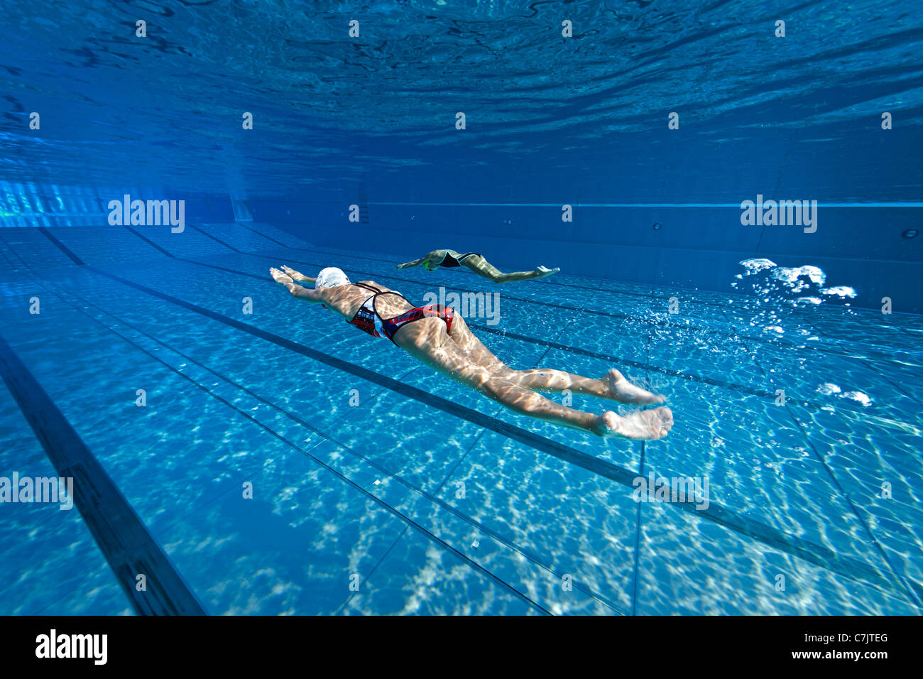 olympic swimming pool underwater. Modren Pool Female Swimmers Training In An Open Air Olympic Swimming Pool France  Underwater View To Swimming Pool U
