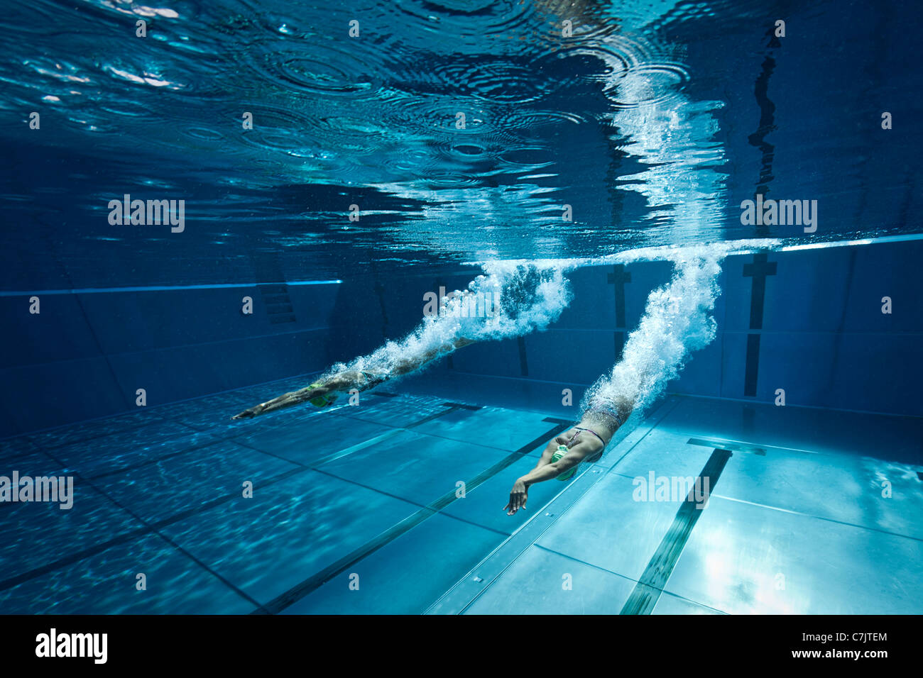 Delicieux Two Female Swimmers Dive Start In An Open Air Olympic Swimming Pool  (France). Underwater View