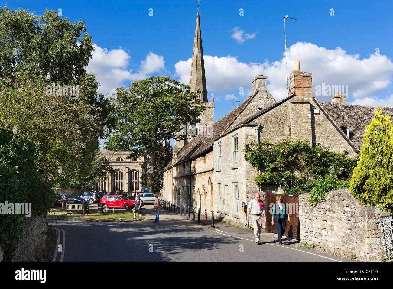 View towards St John the Baptist parish church on Church Lane in the Cotswold town of Burford, Oxfordshire, England, - Stock Image