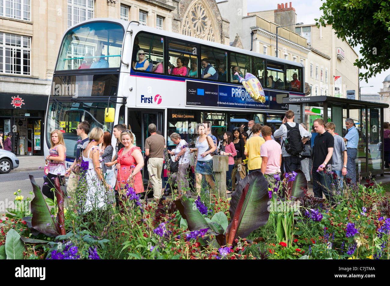 Crowded bus stop on College Green in the city centre, Bristol, Avon, UK - Stock Image