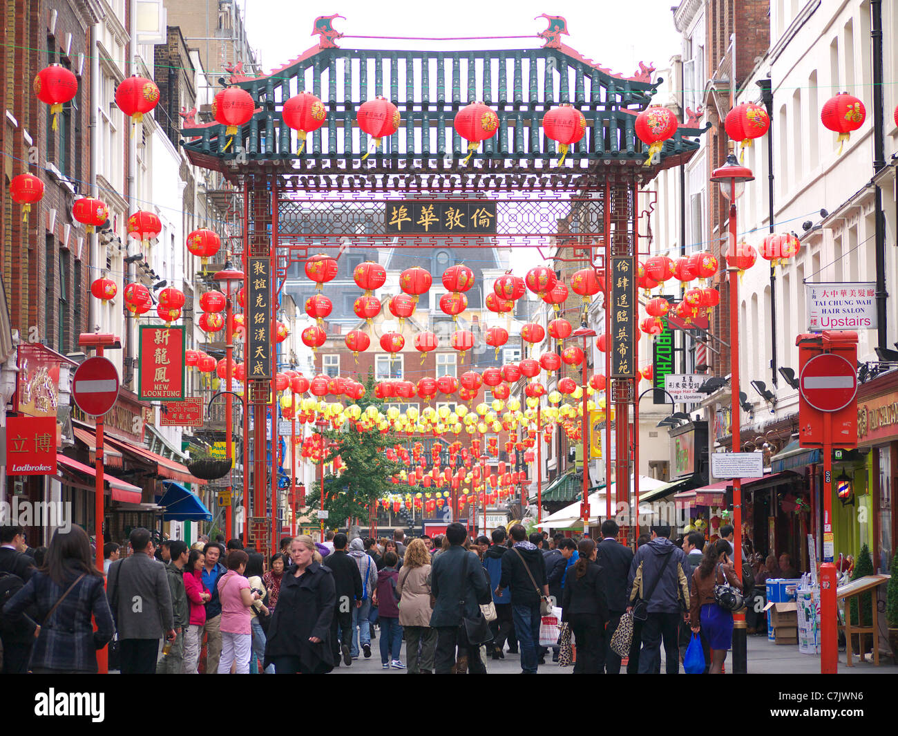 A view along Gerrard Street in London's Chinatown decorated with red lanterns hanging to celebrate the Mid-Autumn - Stock Image