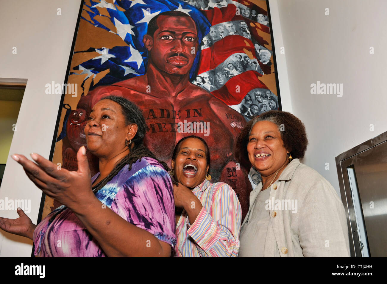3 laughing mature women friends at African American Museum for Portrait  Day, by painting by black artist 2011-09-23 Hempstead NY