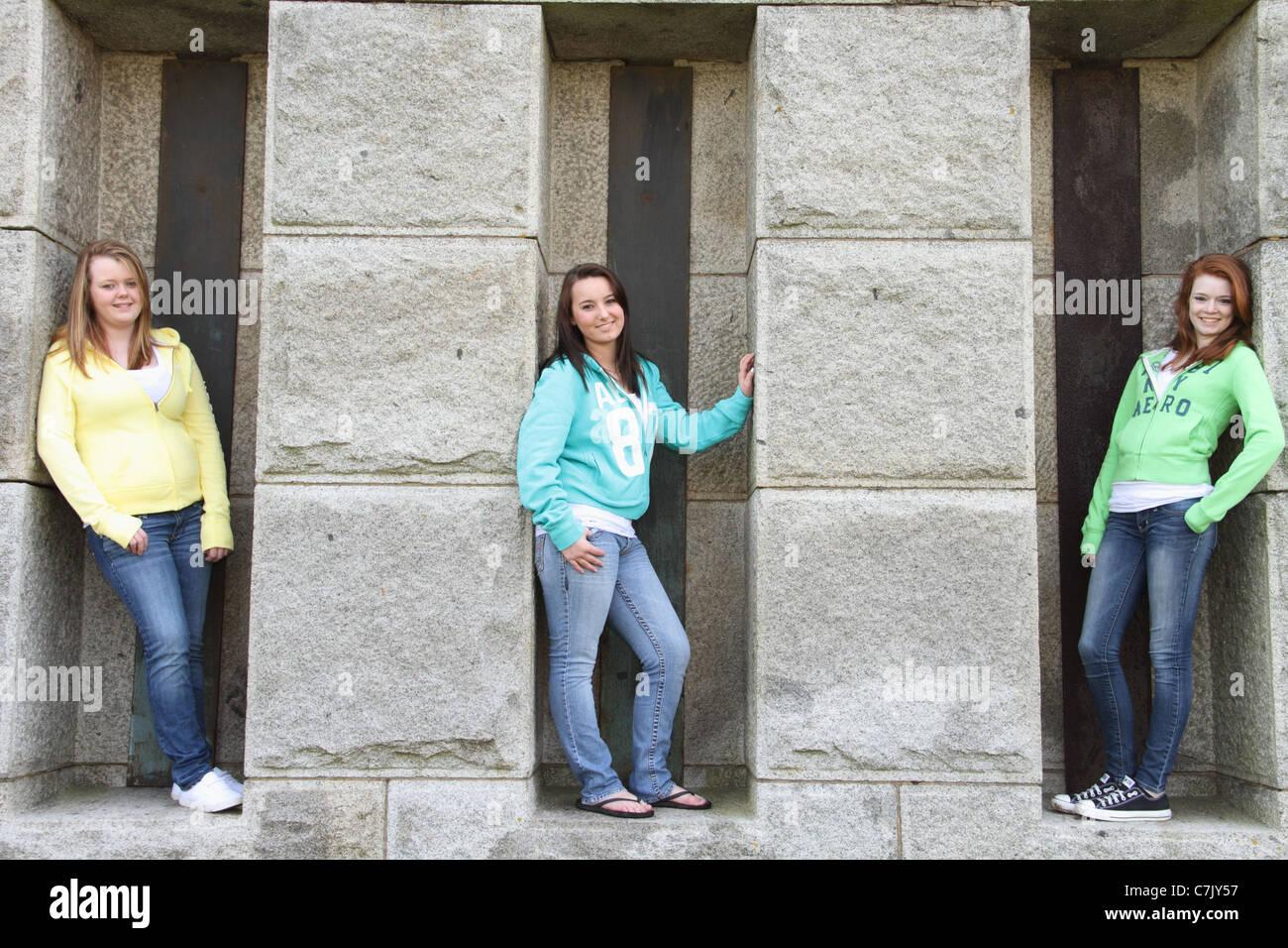 roman numeral  three girlfriends posing teenagers own attitude - Stock Image