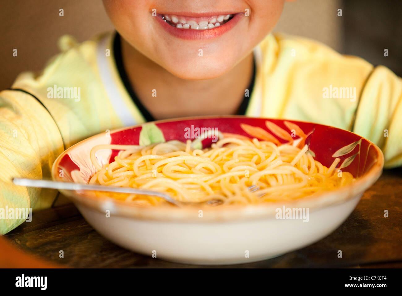 Boy and Spaghetti Bowl - Stock Image