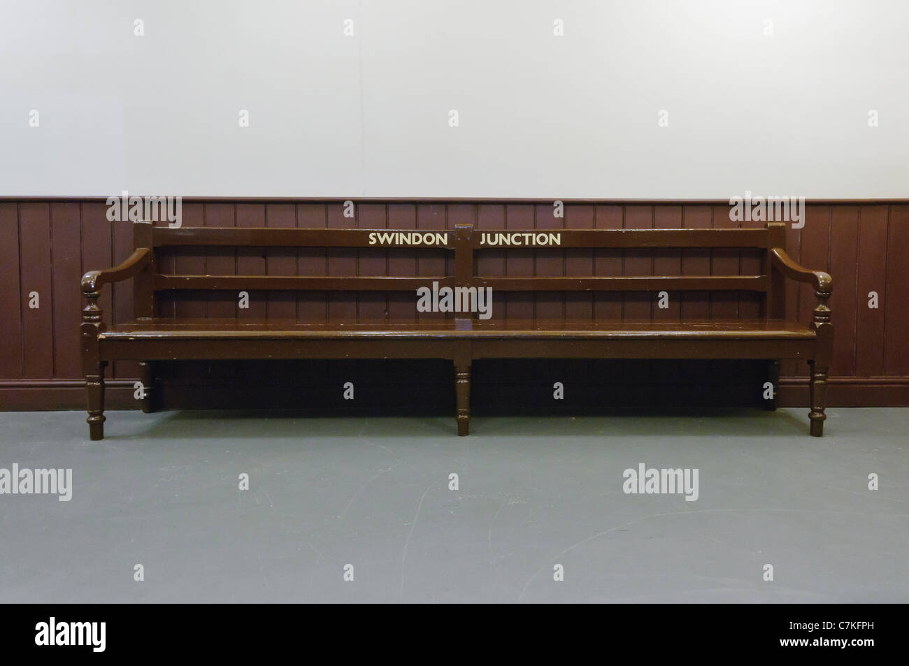 Empty bench marked for Swindon junction railway station - Stock Image