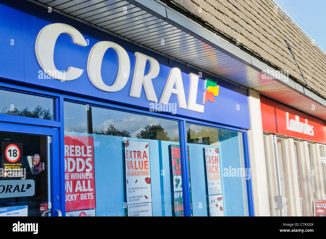 Coral and Ladbrokes betting shops beside each other - Stock Image