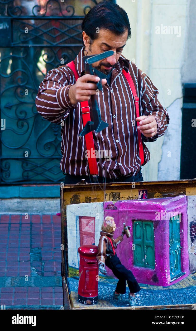 Puppeteer in a street puppet show in Buenos aires Argentina - Stock Image