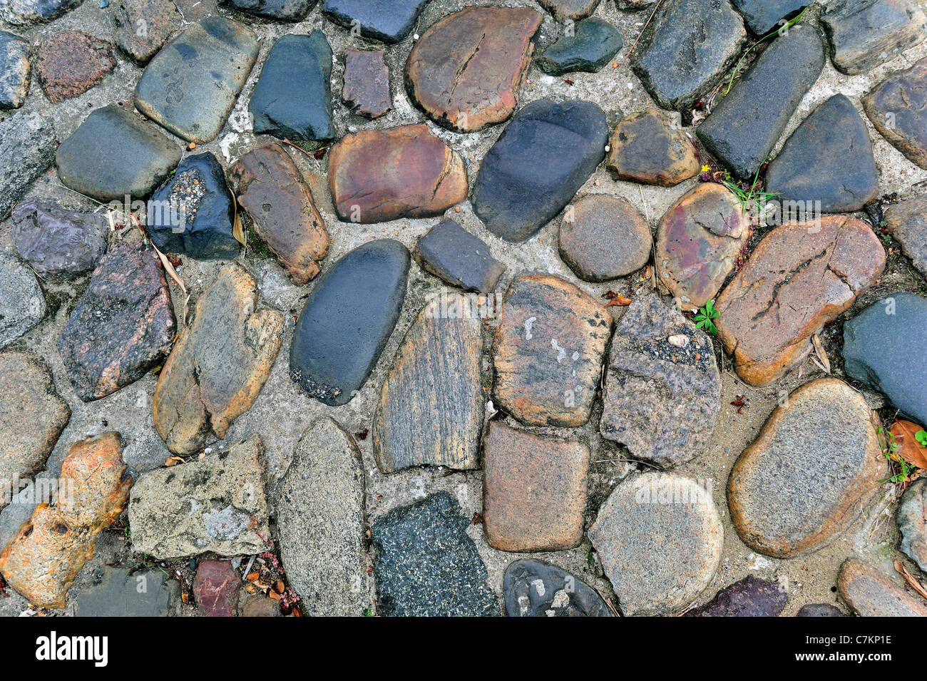 Paved road made of cobblestones, France - Stock Image