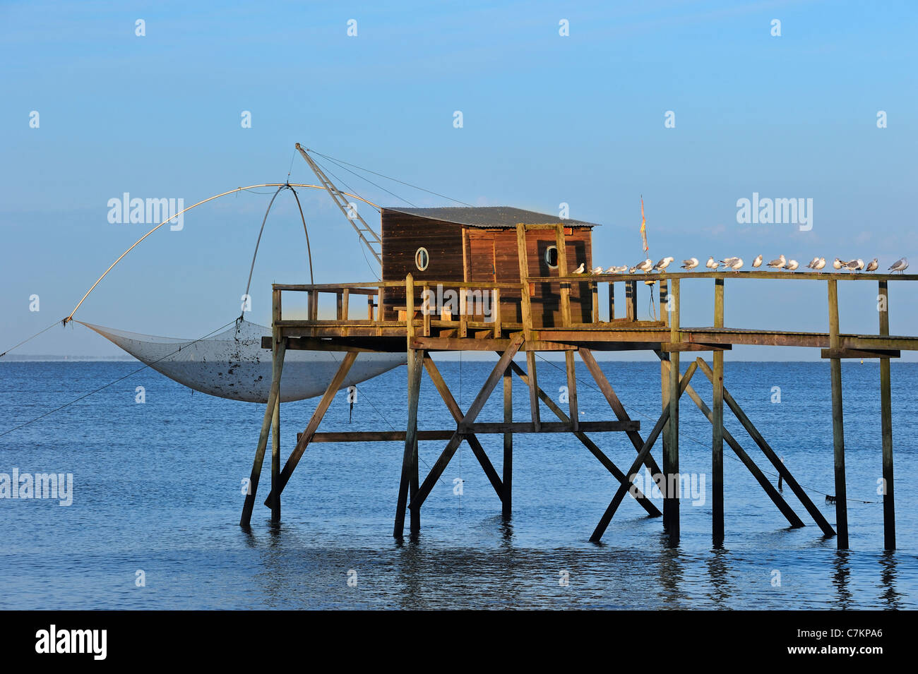 Traditional carrelet fishing hut with lift net on the beach, Loire-Atlantique, Pays de la Loire, France Stock Photo