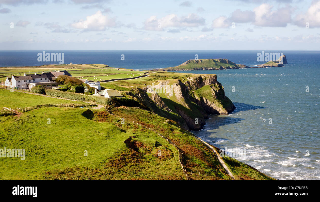 Worm's Head and Rhossili bay on the Gower peninsula Wales - Stock Image