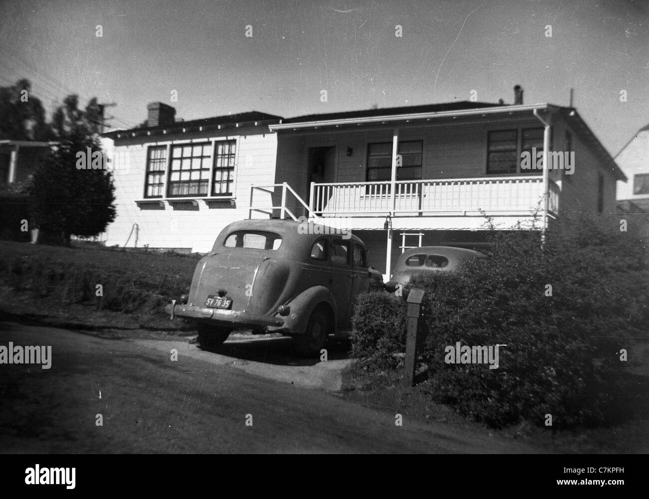 1940s cars parked in front of los angeles southern california house suburbia home day horizontal housing Stock Photo
