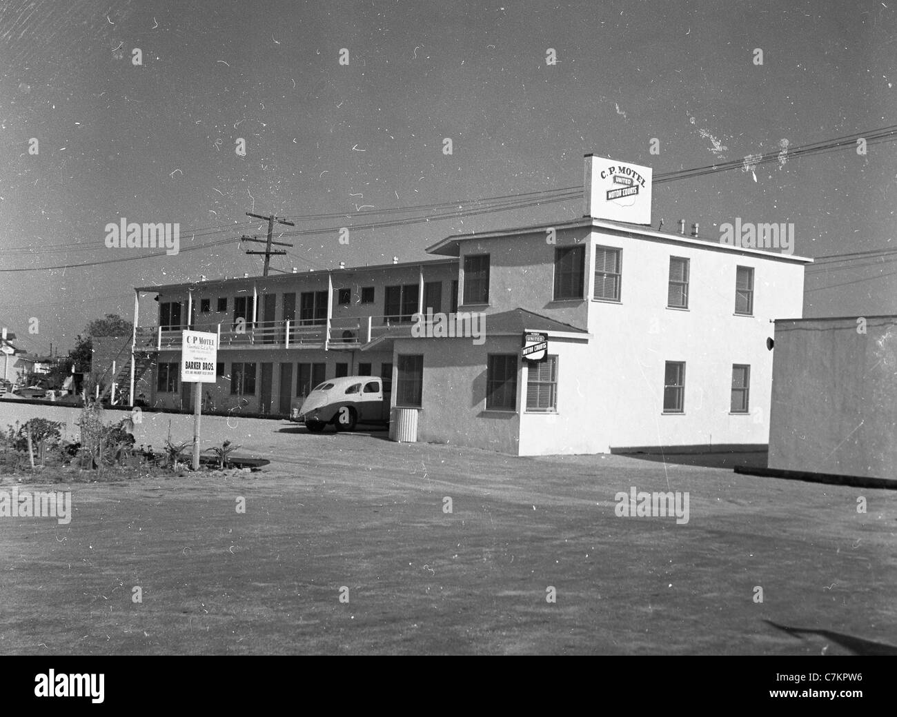 roadside motel two story 1930s southwest united states architecture travel lodging hotel C.P. - Stock Image