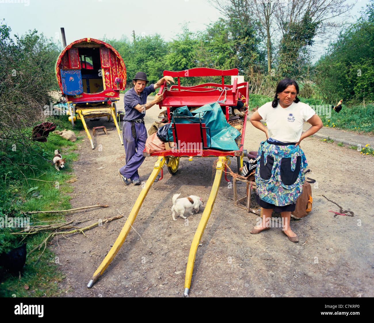 Traditional travelling gipsies with a traditional painted caravan camped near the Cotswold village of Bourton on - Stock Image