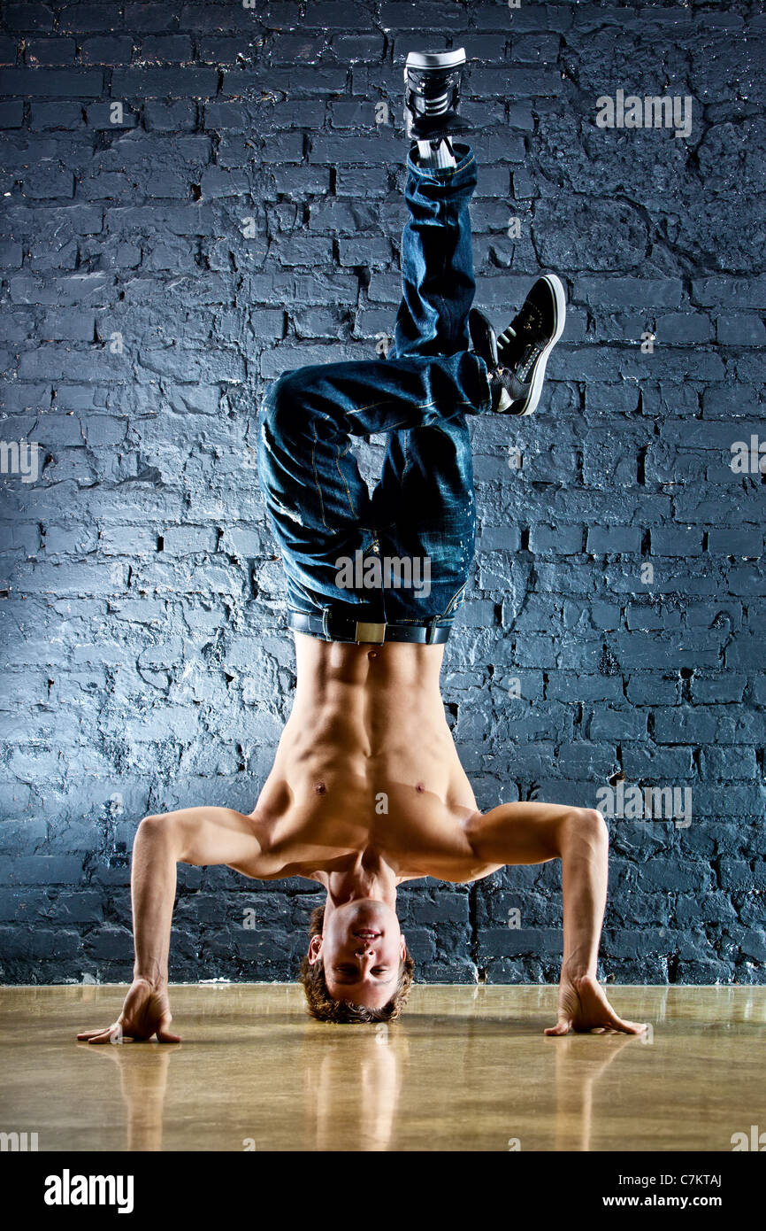 Young strong man break dance. - Stock Image