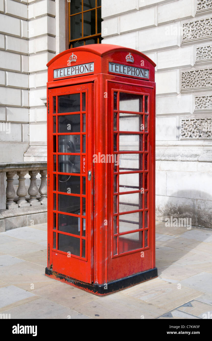 A Traditional Old-Fashioned Red British Telecomm Telephone Kiosk - Stock Image