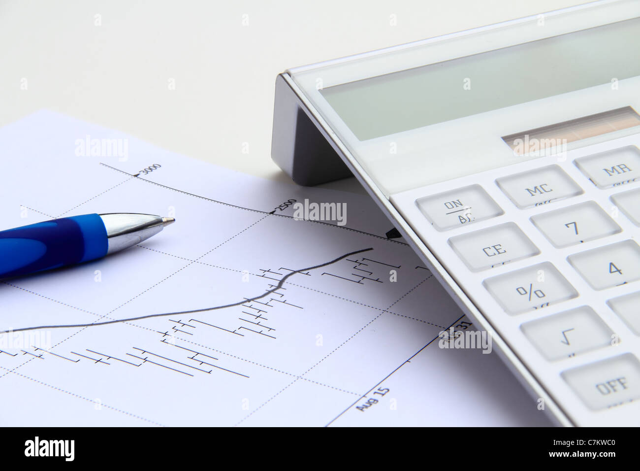 stock chart with solar power calculator and blue pen - Stock Image