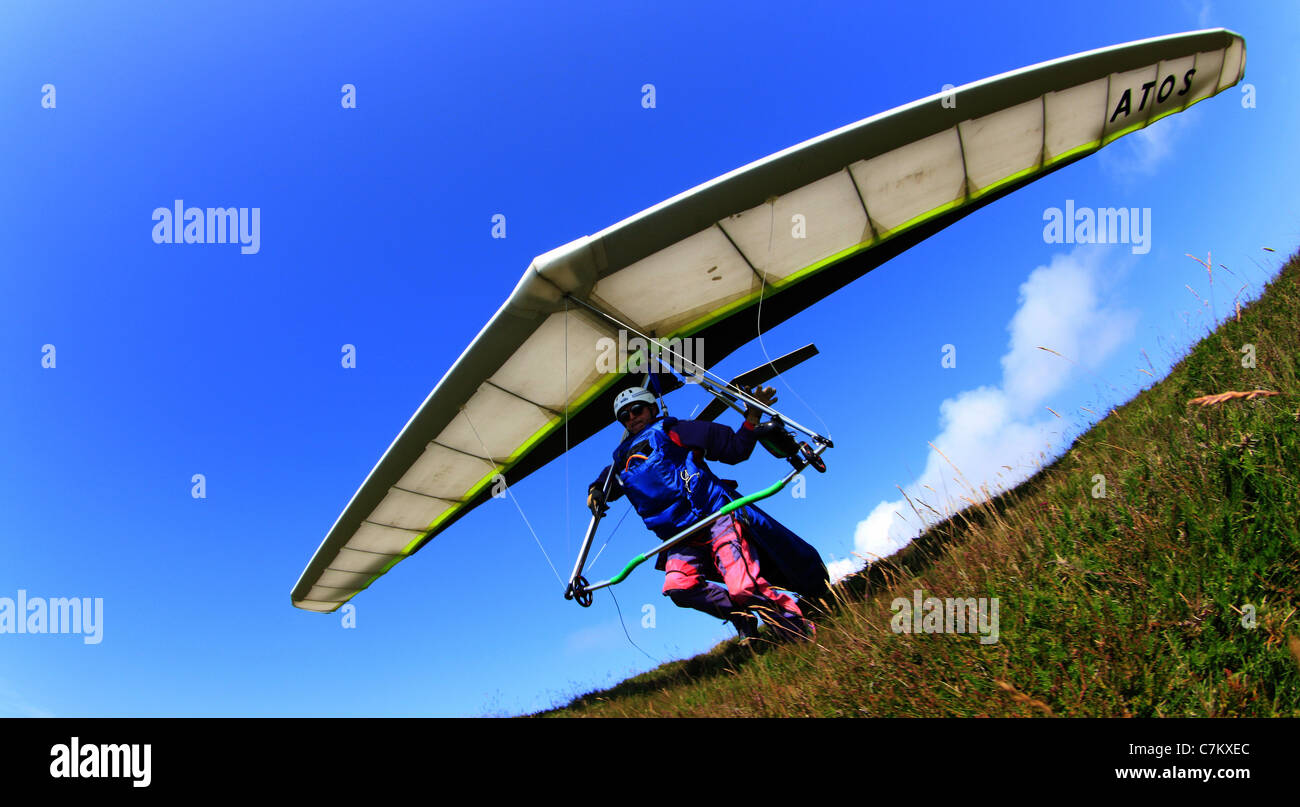Man taking off on hang glider Stock Photo