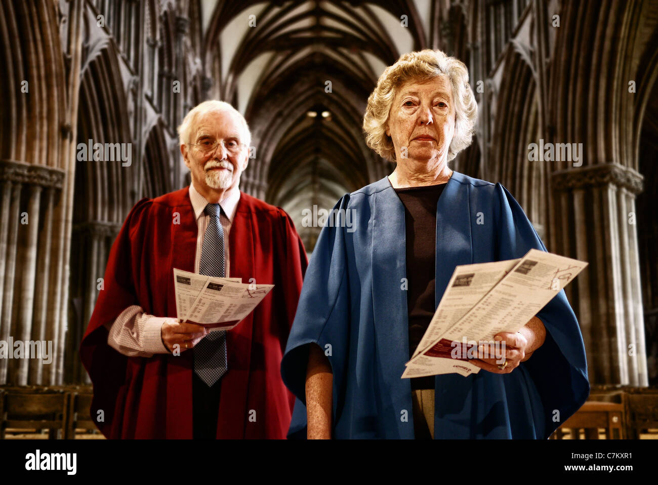 man and woman working as guides in Lichfield Cathedral - Stock Image