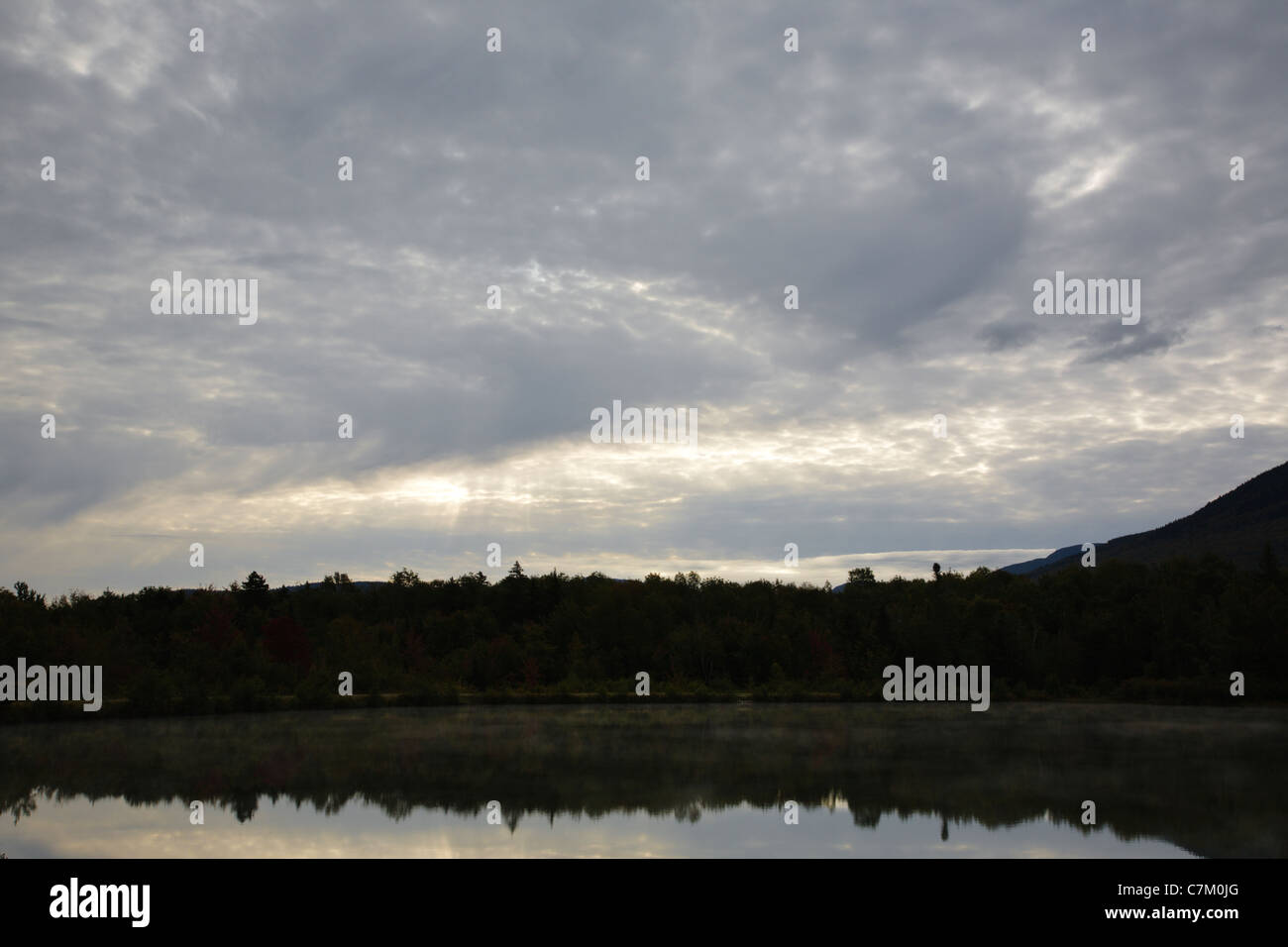 Cloud cover over Durand Lake in Randolph, New Hampshire USA during the summer months - Stock Image
