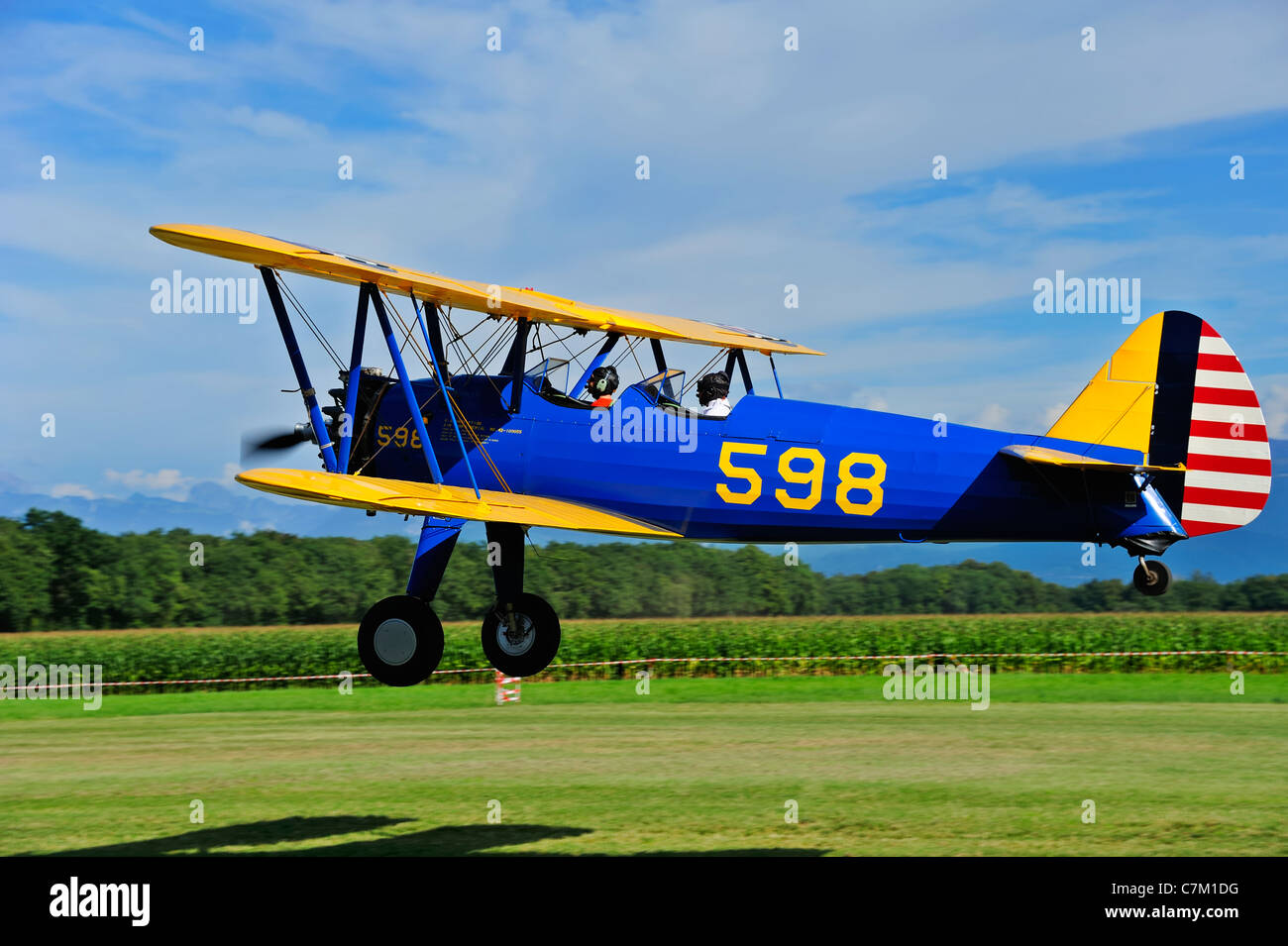 A Stearman Kaydet N2S-5 biplane landing - Stock Image