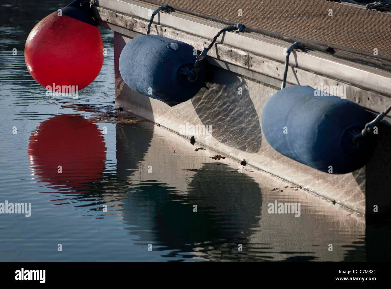 Fenders on side of marina pontoon - Stock Image