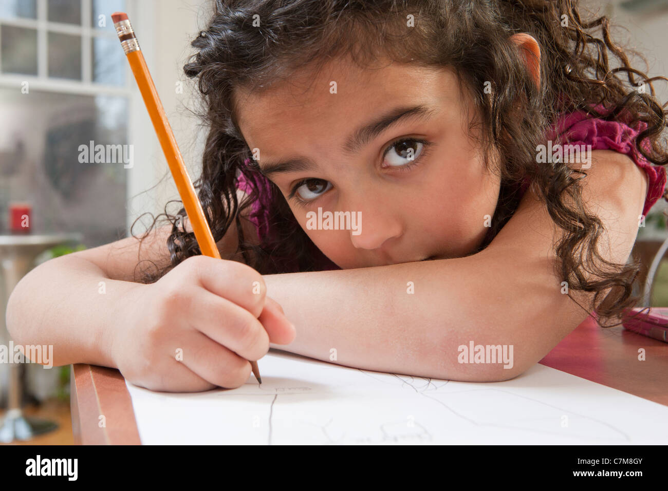 Portrait of a Hispanic girl drawing pictures - Stock Image