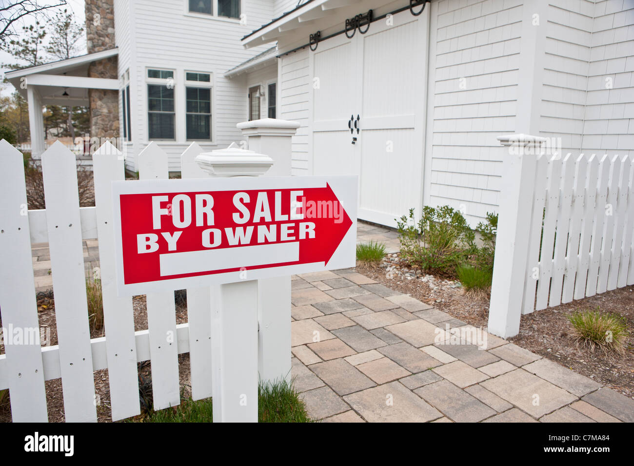 For Sale sign at a Green Technology Home - Stock Image