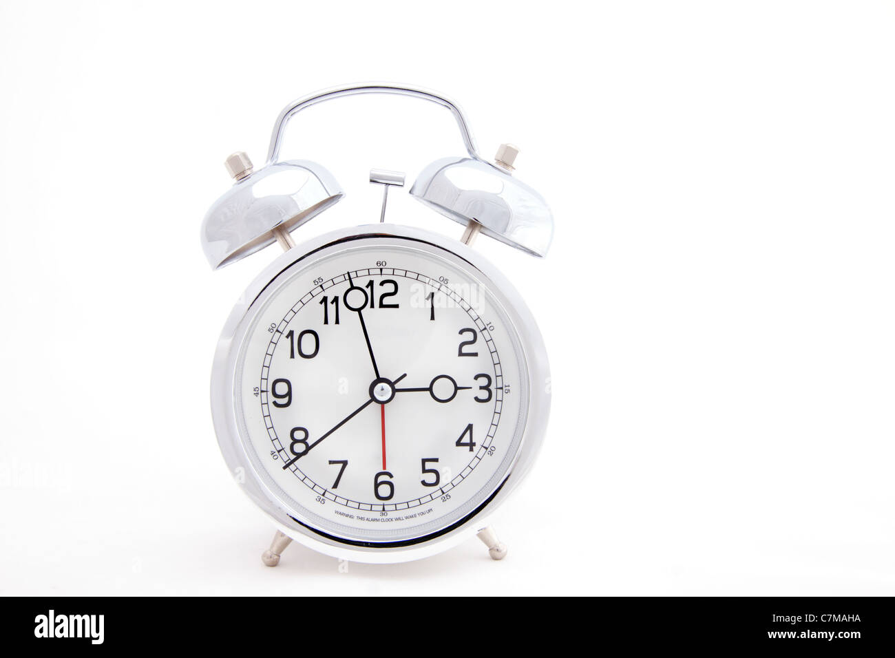 Alarm clock with time approaching 3 O' clock - Stock Image
