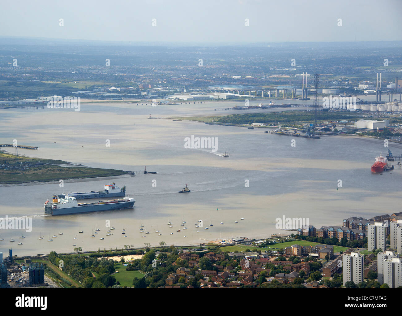 Looking up the River Thames from Tilbury, with the Dartford Crosiing visible, South East England - Stock Image