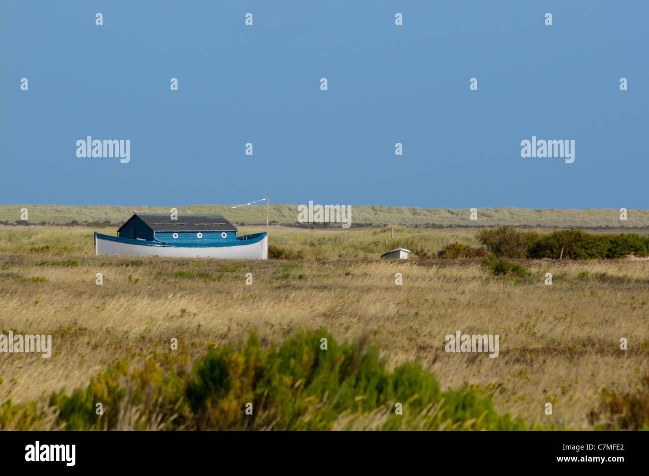 Small house boat like Noahs ark on Stiffkey  marshs - Stock Image