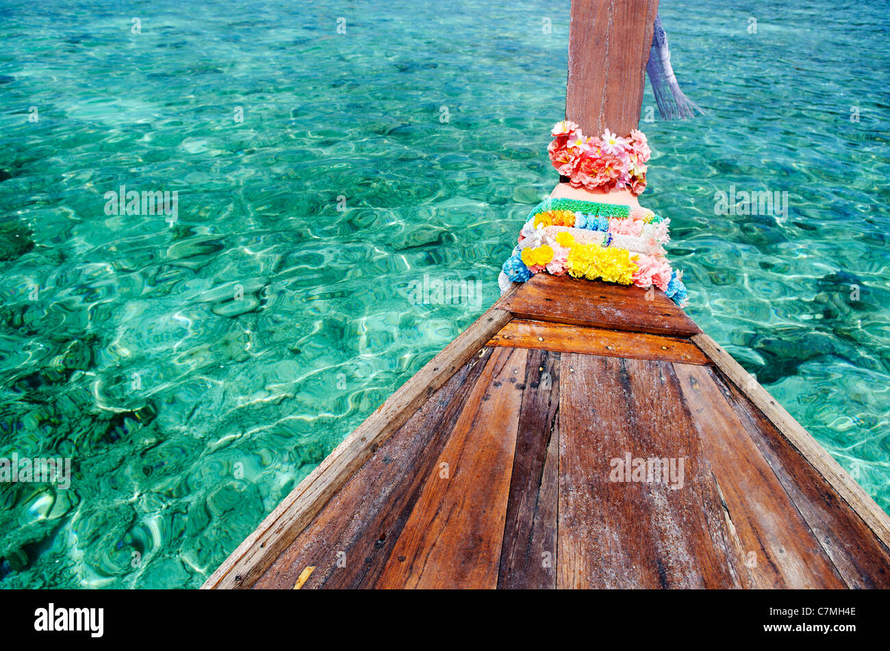 turquoise tropical island sea water and thai boat - Stock Image