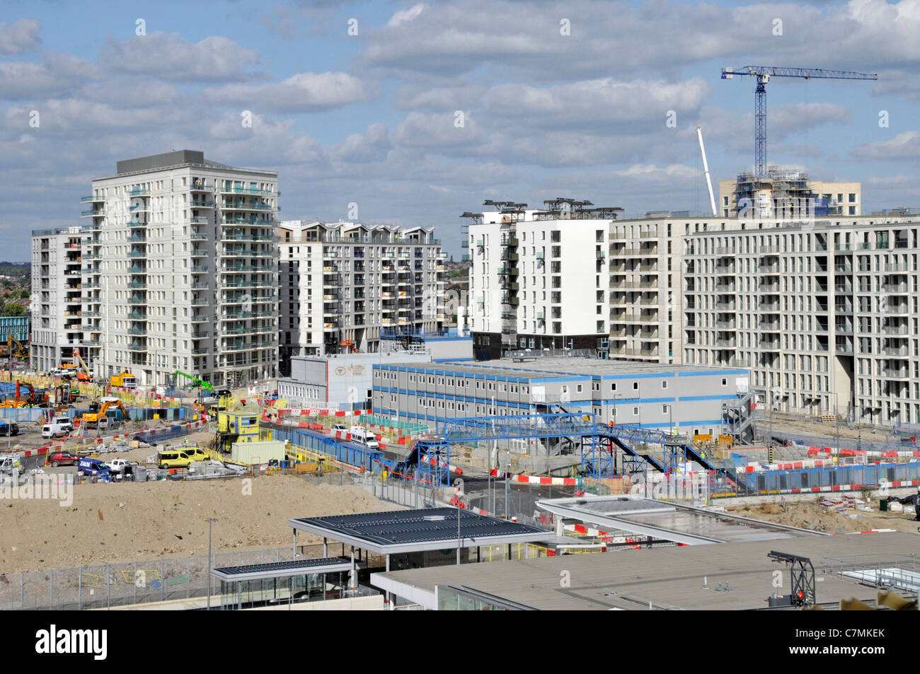 Part of the London 2012 Olympic village construction site with temporary site offices - Stock Image