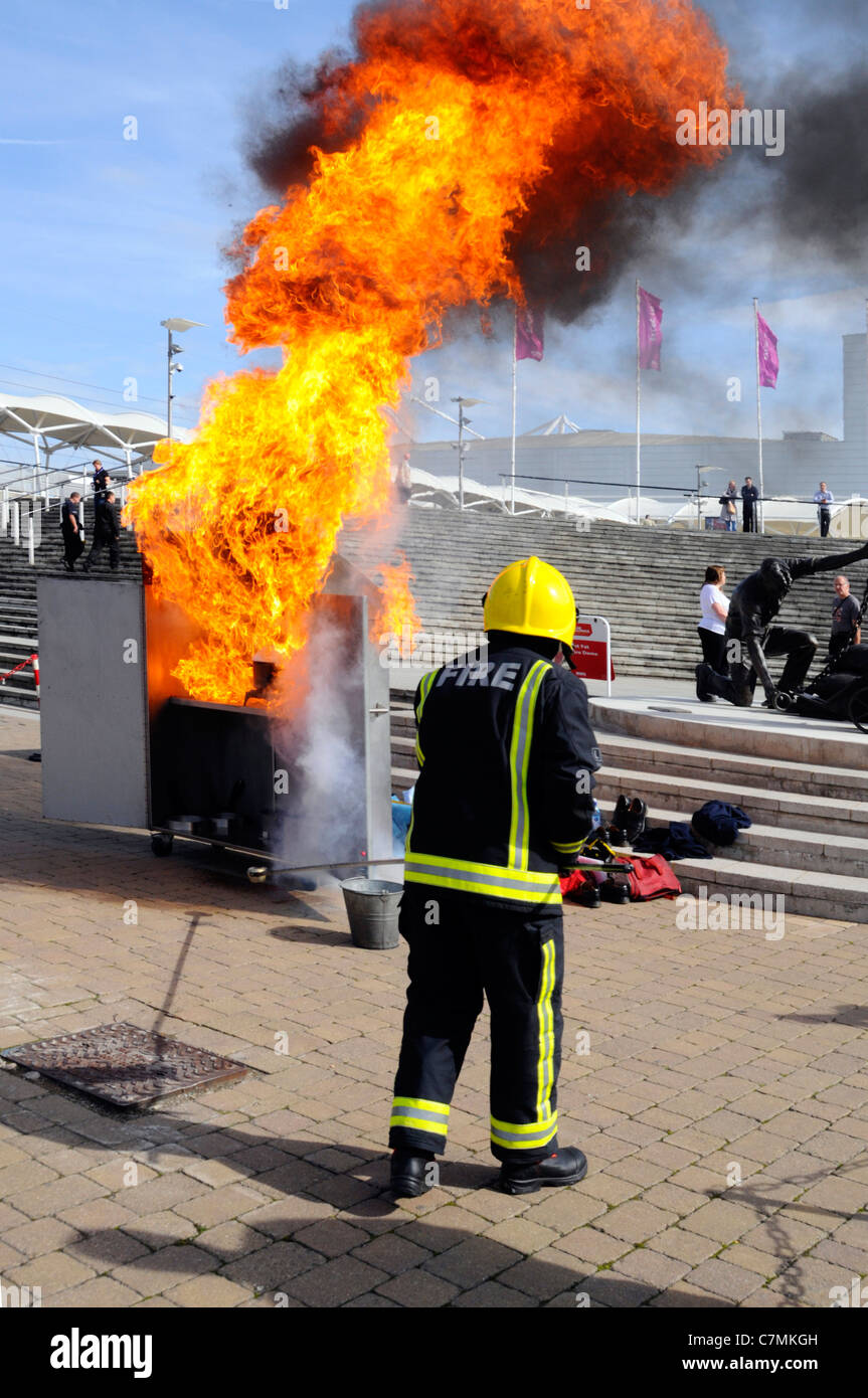 Hot Fat fire hazard demonstration by the London Fire Brigade at UK Rescue Challenge event simulating chip pan fire - Stock Image