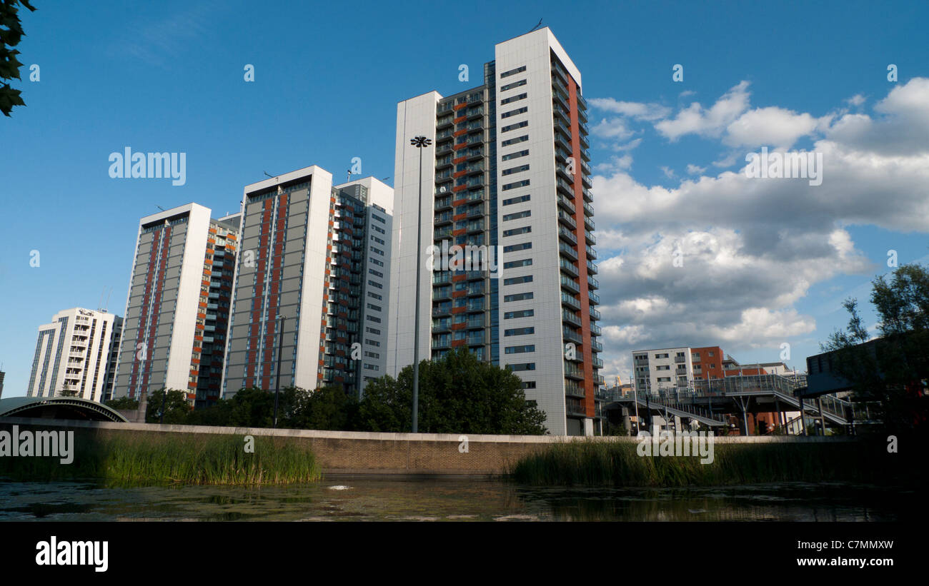 New high rise housing apartment buildings tower blocks (towers) at Virginia Quay flats against skyline near DLR - Stock Image