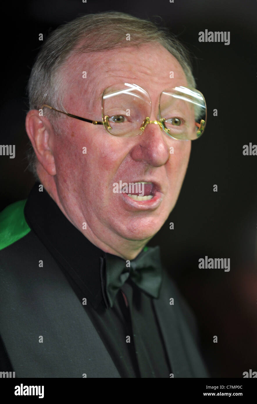UK, Dennis Taylor, former World Snooker Champion and BBC commentator playing a set of exhibition games Stock Photo