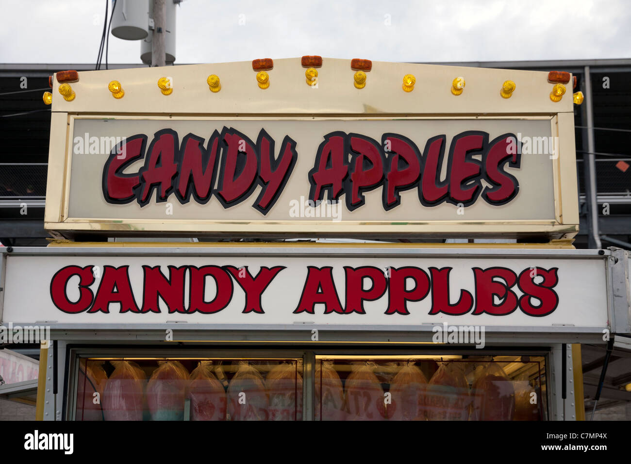 Candy Apple Vendor at county food fair Michigan USA Stock Photo