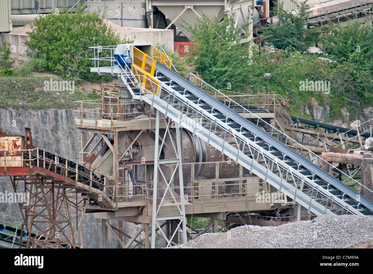 Conveyor belt in a large quarry ready to transport stone - Stock Image