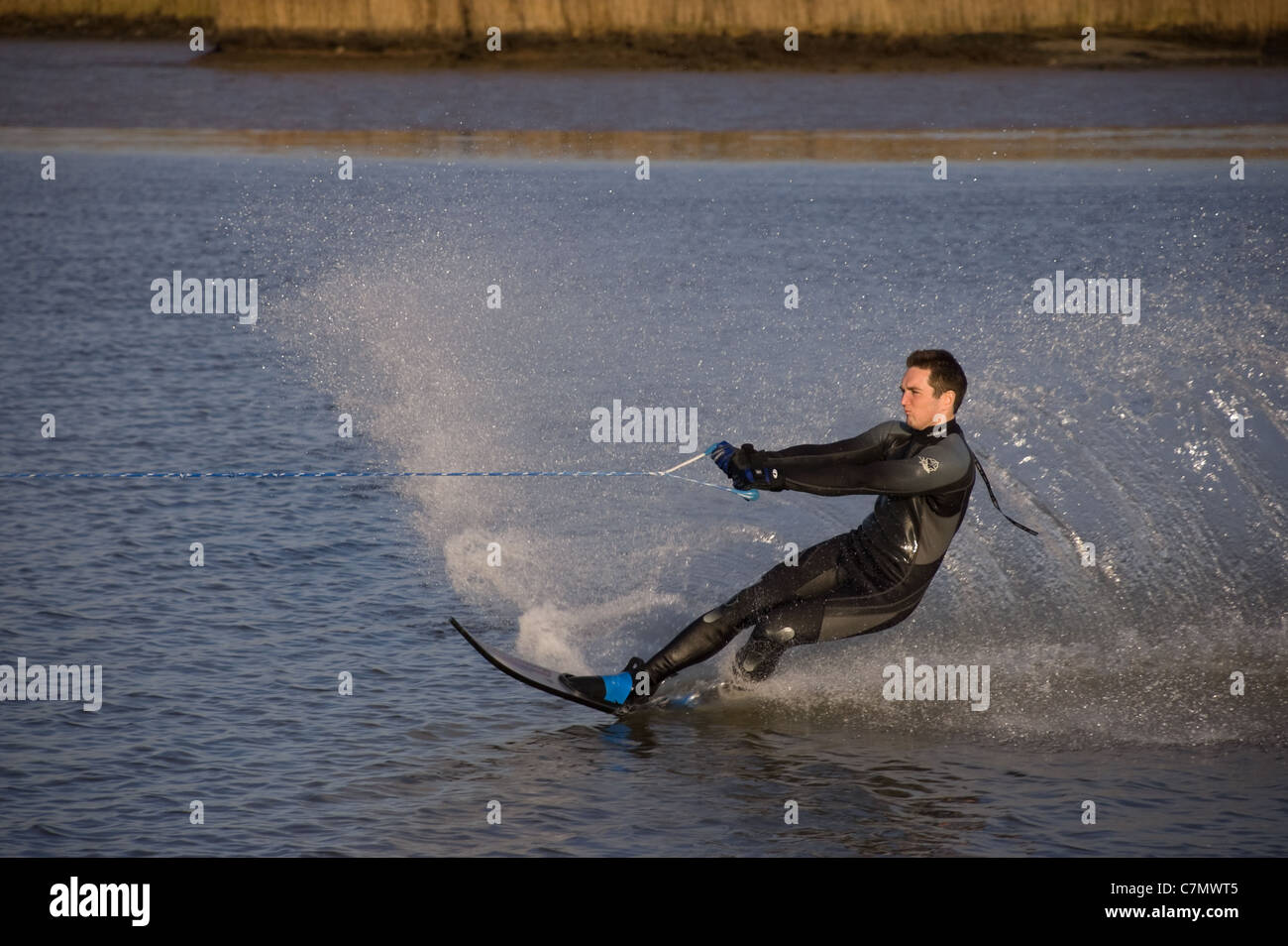 Young man wakeboarding on the River Yare Norfolk BroadsStock Photo