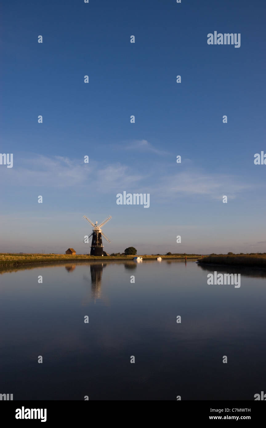 Looking across the calm waters of the River Yare towards Berney Arms windpump on the Norfolk Broads Stock Photo