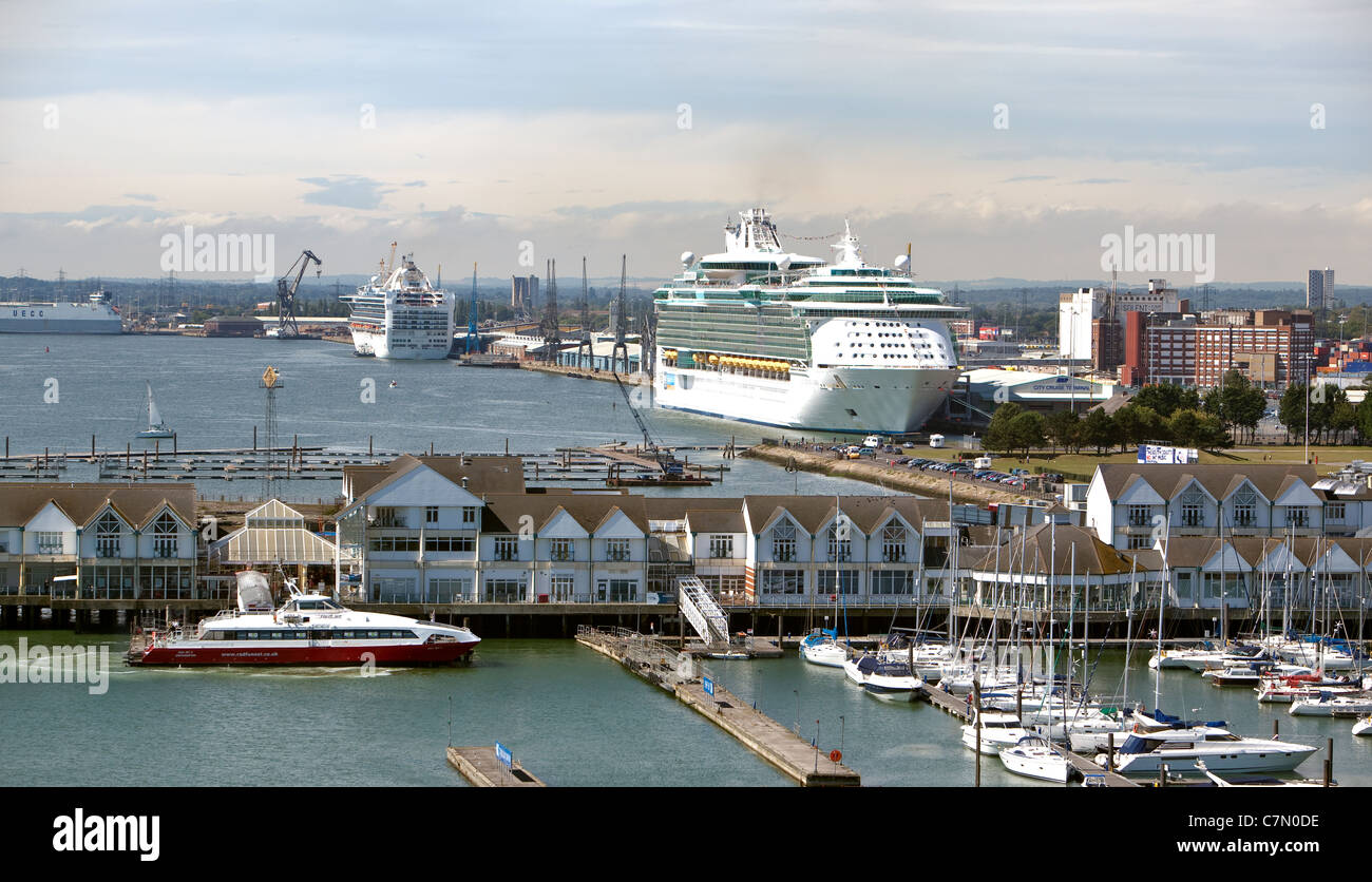 Port of Southampton looking across at a cruise ship loading passengers at the  Western docks. Southampton waterfront - Stock Image