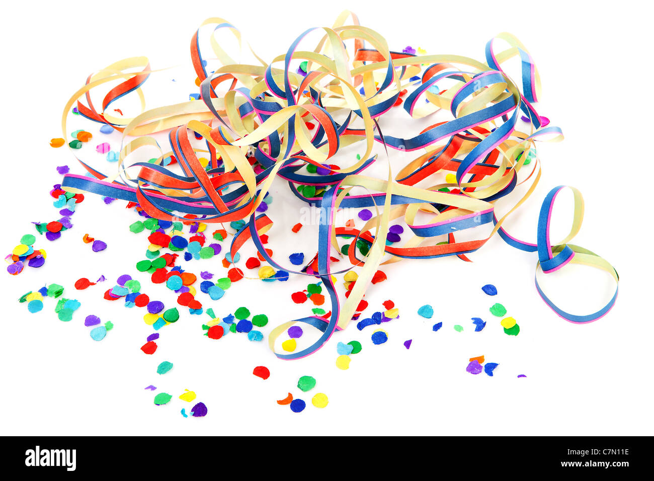 colorful confetti and party streamers over white background - Stock Image