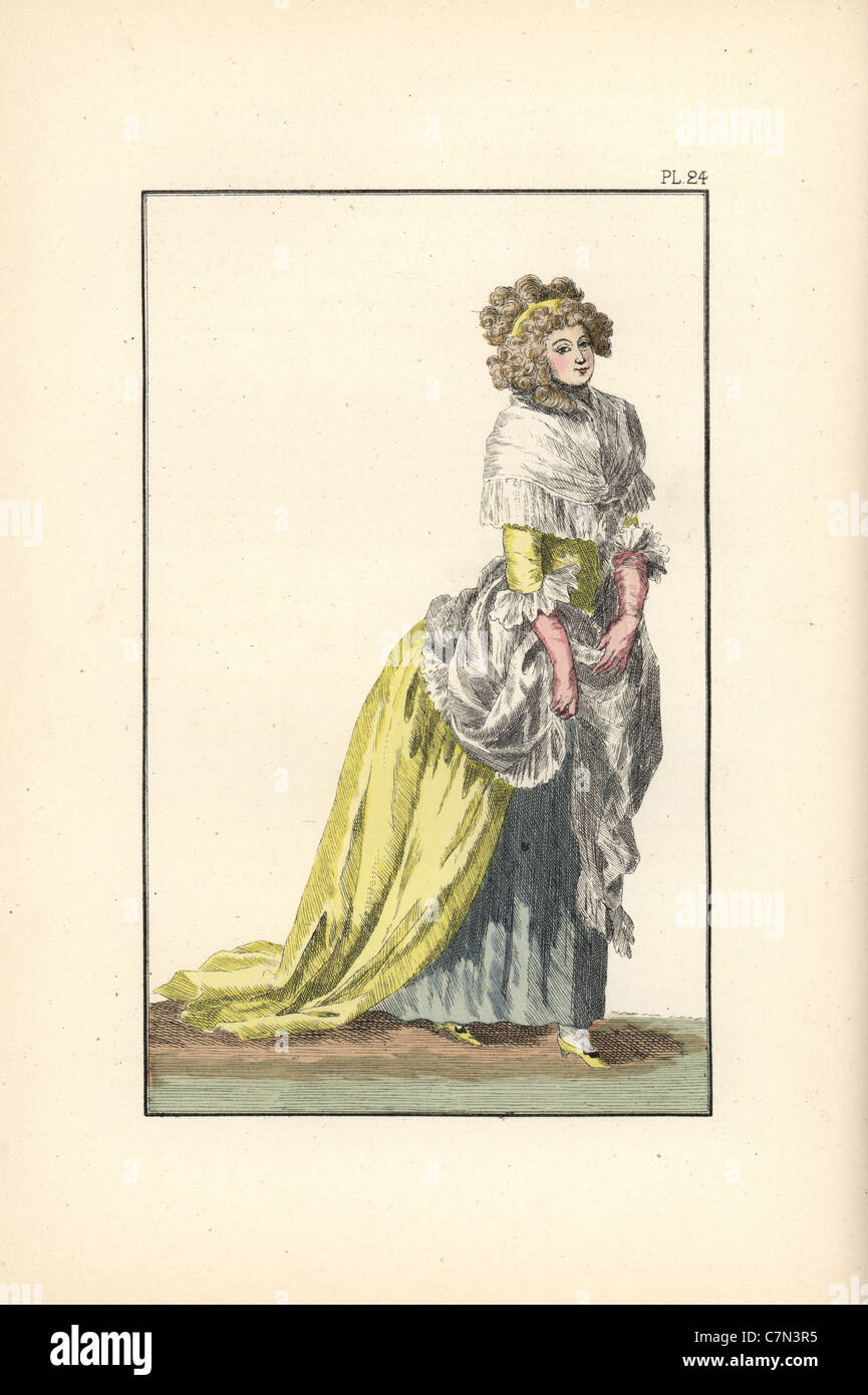 Woman wearing a dress of English silk with hair in the councillor style. - Stock Image