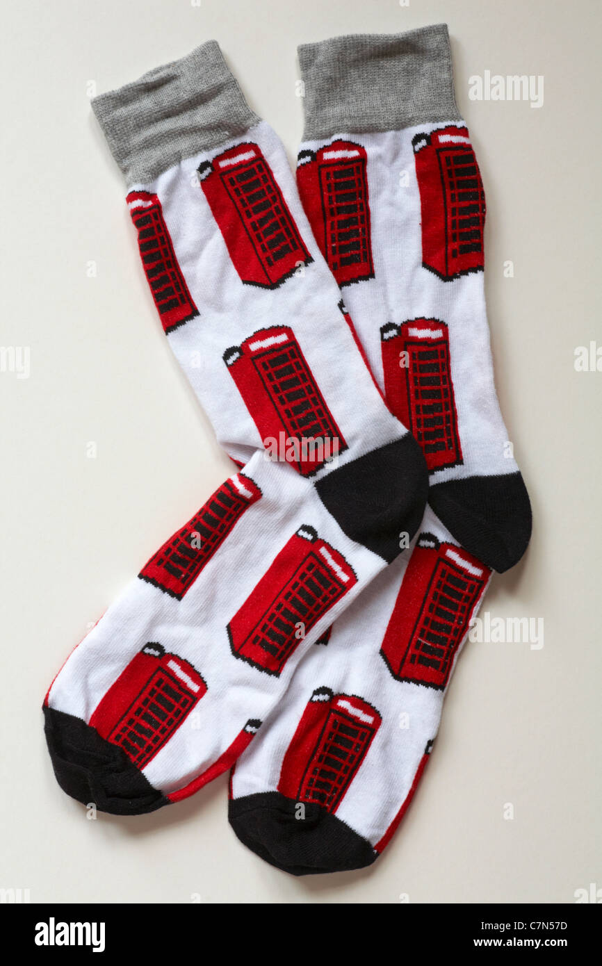 Pair of novelty socks with red telephone boxes on isolated on white background - Stock Image