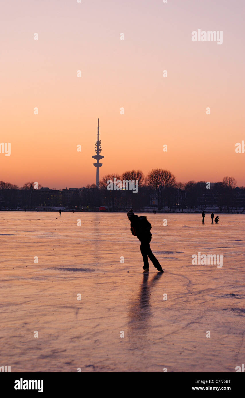 Firmly frozen Aussenalster, Outer Alster Lake, after sunset, people, amusement, ice, snow, winter, Hamburg, Germany Stock Photo