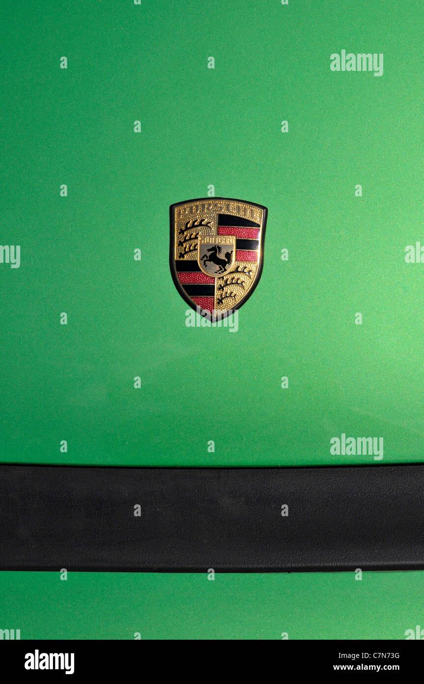 Porsche emblem on the hood of an automobile - Stock Image