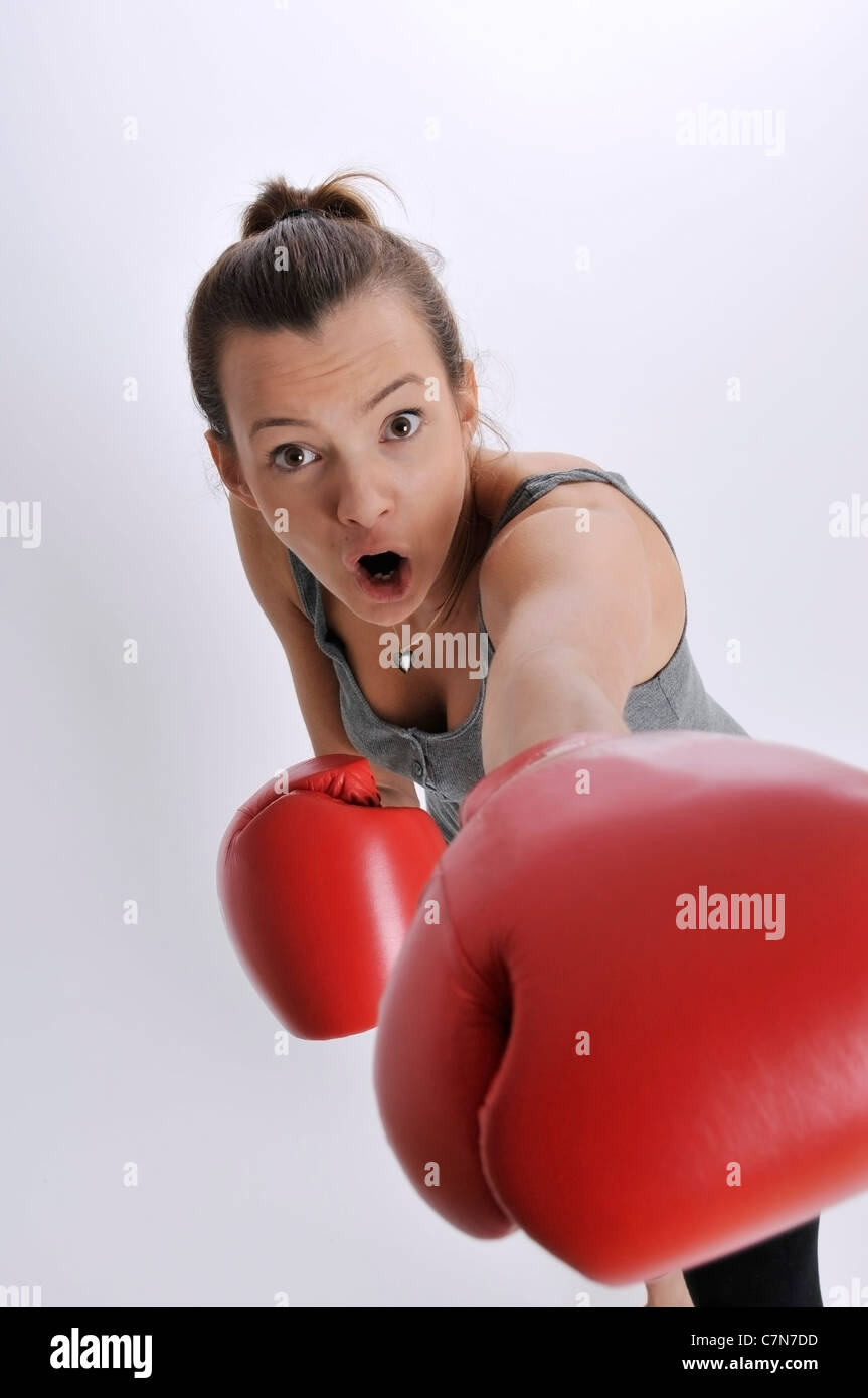 Young woman, 24, red boxing gloves - Stock Image