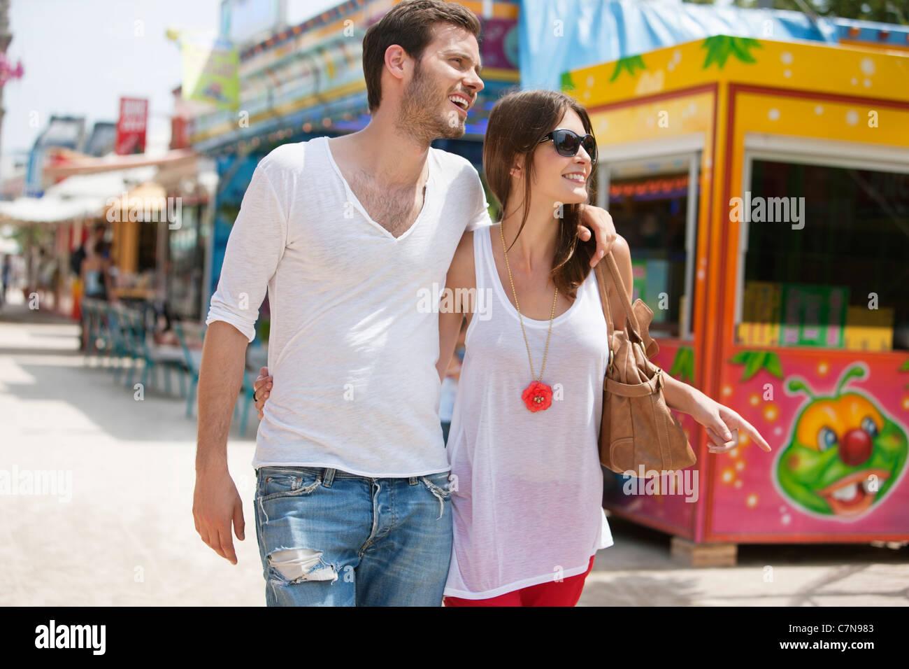 Couple walking in amusement park, Jardin des Tuileries, Paris, Ile-de-France, France - Stock Image