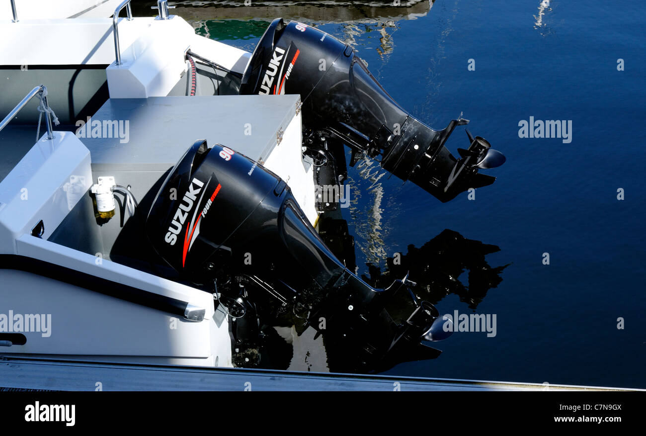Two outboard motors raised out of the water in Swansea, Wales - Stock Image